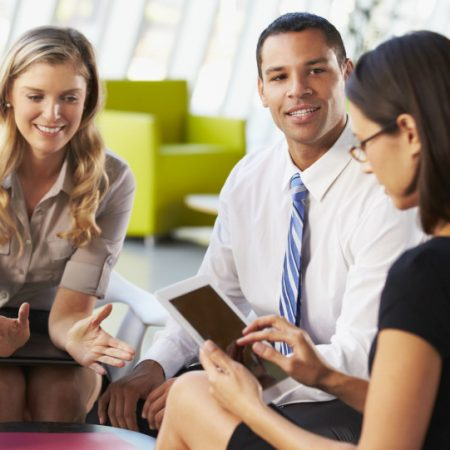18736483 - businesspeople with digital tablet having meeting in office